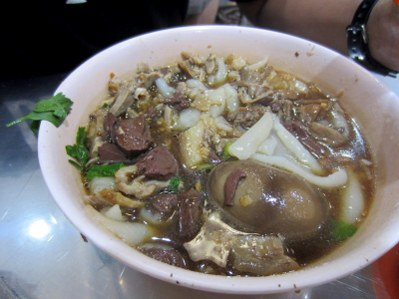 Offal soup with century duck egg