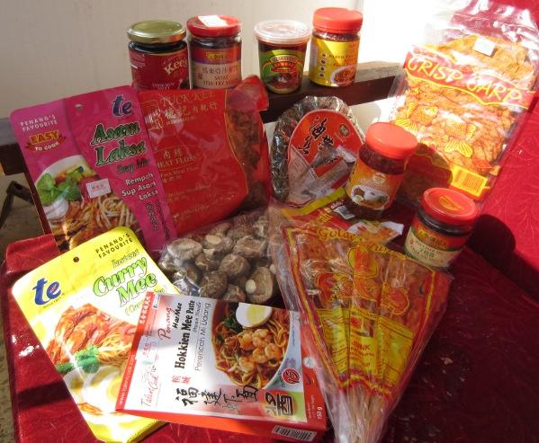 Sambal, hokkien mee, char sieu, crispy carp, jelly fish satay, laksa, seaweed and meat floss