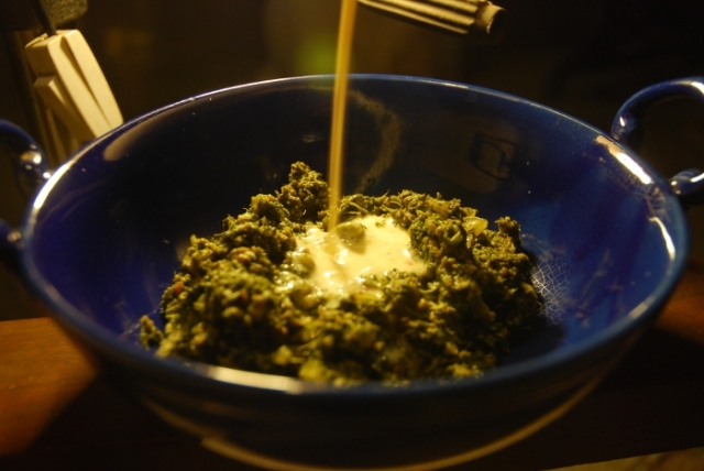 Cheese sauce poured over spinach